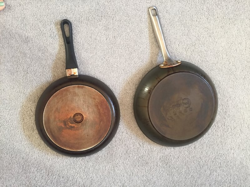 Two frying pans. One is a Greenspan. 4e0e8a94-ba7f-4a60-8736-7a97f7f69933