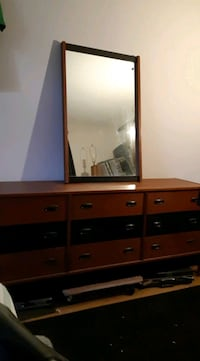 Shows  dresser   of bedroom set  chest and