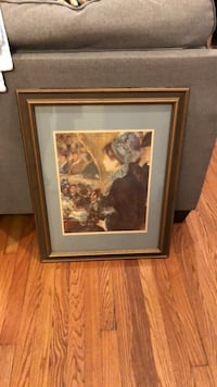 brown wooden framed painting of woman Raleigh, 27607