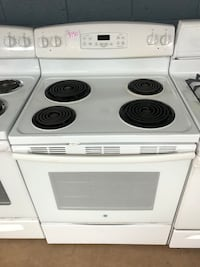 GE white electric coil range stove