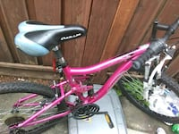 pink and white full-suspension bike