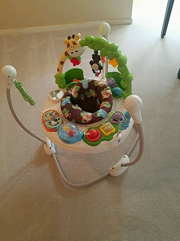 baby's white and green jumperoo