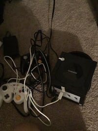 black Nintendo 64 with controller 60 km