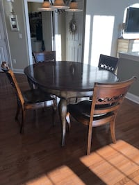Round brown wooden table with four chairs dining set Haymarket, 20169