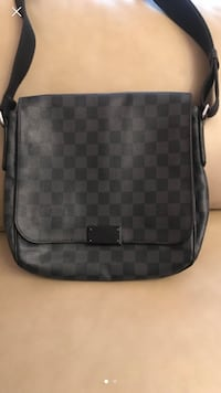 black and gray Louis Vuitton leather sling bag