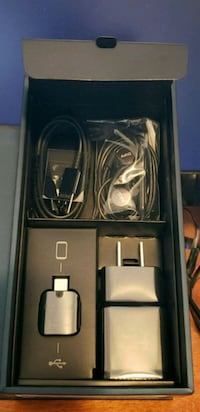 black Samsung Galaxy smartphone with charger and earphones Cudahy, 53110