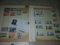 assorted postage stamps with album Huntsville, 35810
