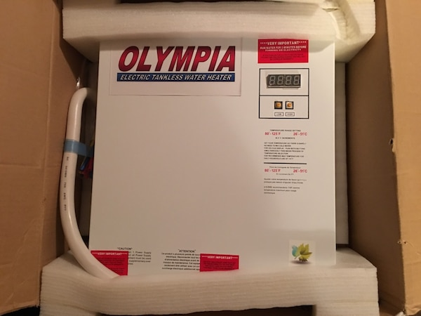 used white olympia electric tankless water heater for sale in