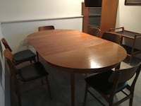 round brown wooden table with four chairs dining set White Rock