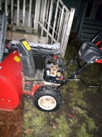 black and red snow thrower