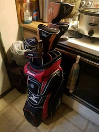 red and black golf bag with golf clubs Winnipeg, R3T 0N2