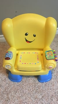 toddler's yellow and blue Fisher-Price musical armchair toy Grandville, 49418