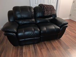 Black leather electric reclining love seat & sofa