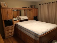 brown wooden bed frame and white mattress Falls Church, 22046
