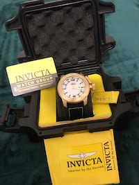 Round gold-colored invicta chronograph watch with box Laurel