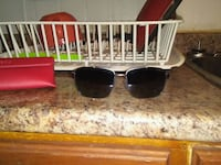 black framed sunglasses with red lens St. Catharines, L2R 3E9
