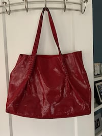 Red tote. Reversible. Removable organizer pouch included.