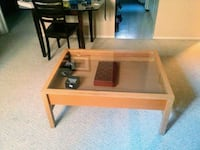 brown wooden framed glass top coffee table Edmonton, T6T 1M7