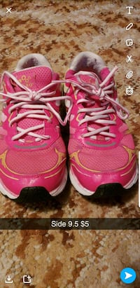 pair of pink Nike running shoes Eau Claire, 54703