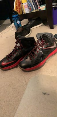 Pair of black-and-red nike basketball shoes Bristow, 20136