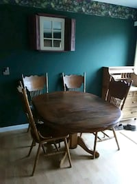 round brown wooden table with four chairs dining set Ridgely, 21660