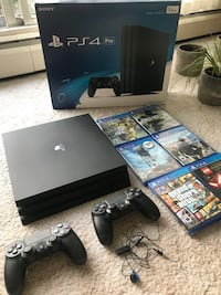 Play Station 4 Pro 1TB, two controllers, earphones, power adapter, HDMI Cable, 6 games ( Grand Theft Auto V, CallDuty, Watch Dog, Battlerfront, Starwars Lego, Fifa 17). Great Condition, no scratches, no bumps. Burnaby, V5A 3B4