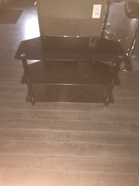 "50"" glass tv stand, barely used 200$ obo Beaumont, T4X"