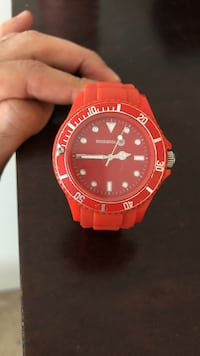 round red and black analog watch with red strap Richmond, V6Y 1Y7