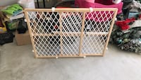 Brown wooden frame baby gate