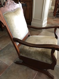 Antique Rocker with original wheels in front legs Luling, 70070