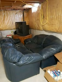Free Leather couches, tv stand and tv