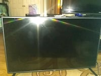 black flat screen TV with remote Waldorf, 20601
