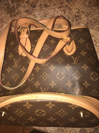 black and brown Louis Vuitton sling bag