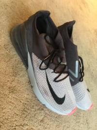 pair of gray-and-black Nike running shoes Fort Washington, 20744