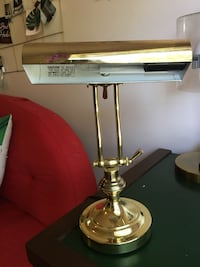 brass and white table lamp