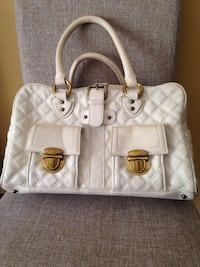 white leather quilted handbag