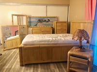 brown wooden bed frame with white mattress Moreno Valley
