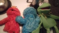 Elmo,Cookie monster,Kermit the frog puppets
