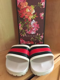 pair of white-and-red Adidas slide sandals Little Rock, 72223