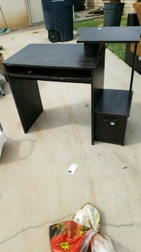 black wooden single pedestal desk Imperial