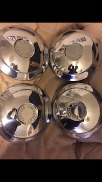Set of four Chevy Corvair hubcaps and mint condition