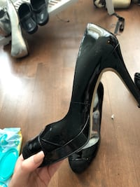 pair of black leather peep-toe platform stilettos Blainville, J7B 1Y1