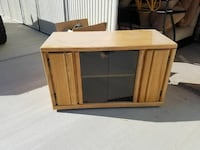 brown wooden framed glass TV stand