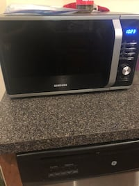 Black and gray samsung microwave oven Oak Park, 60301