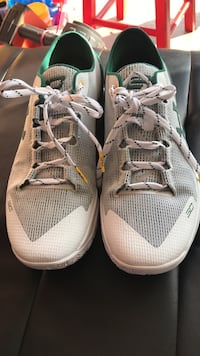 gray-green-and-white Under Armour Stephen Curry basketball shoes