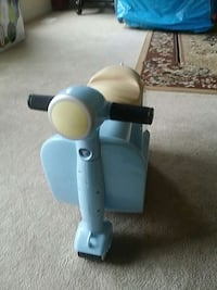 toddler's blue ride on toy