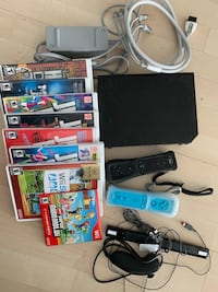Nintendo Wii Holiday Bundle Black Console plus an extra controller and some games Toronto, M2N 6T5