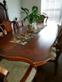 Solid dining room table with 6 chairs