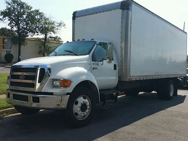 white Ford Transit dropside truck