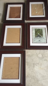 five brown wooden photo frames